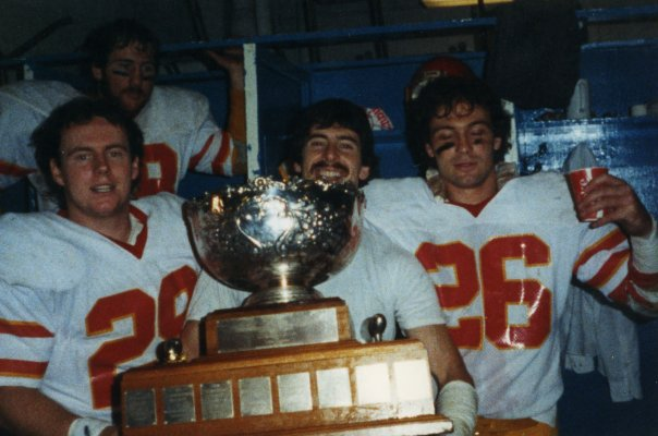 1984 Vanier Cup Champions Pat Tracey #29, Mike Knighton, Steve MacMillan, Daryl Skuse (back)