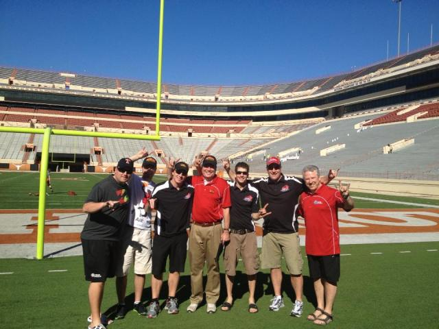 Gryphon coaches visit Univ of Texas stadium while in Austin