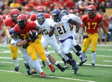 Rookie RB Johnny Augustine runs through WLU tacklers Photo: Rob Massey