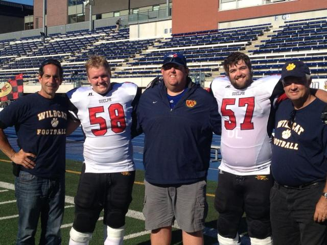 #58 Piotrowski and #57 Thorn with their high school coaches [middle: Jeremy Oxley]