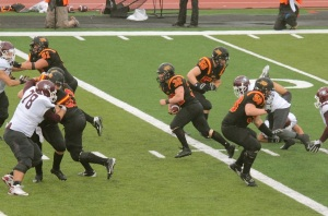 O-Line opening holes for #32 Rob Farquharson Photo credit: Lou Toppan