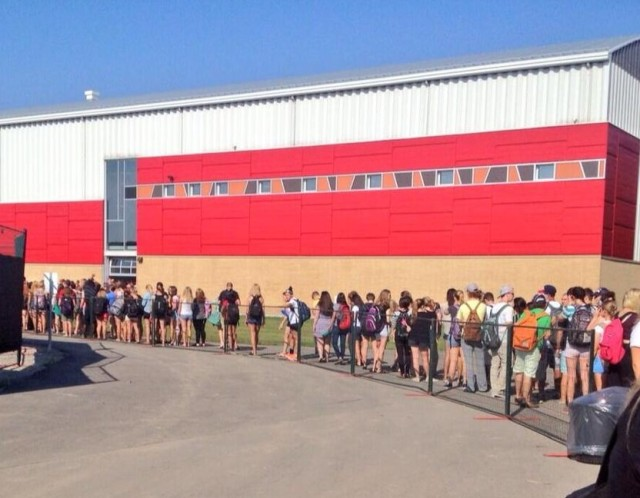 Univ of Guelph students lineup for Homecoming Game tickets