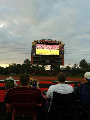 Players are watching the NFL's first Monday Night  game on Alumni Stadium's big screen