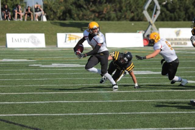 Saxon Lindsey picks up yardage after the catch Photo: Lou Toppan