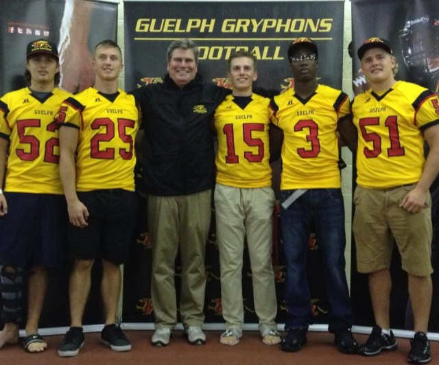 The first members of Guelph's 2014 Recruiting Class #52 Drew Walden, #25 Nick Parisotto, HC Stu Lang, #15 James Roberts, #3 Malik Richards, #51 Luke Korol