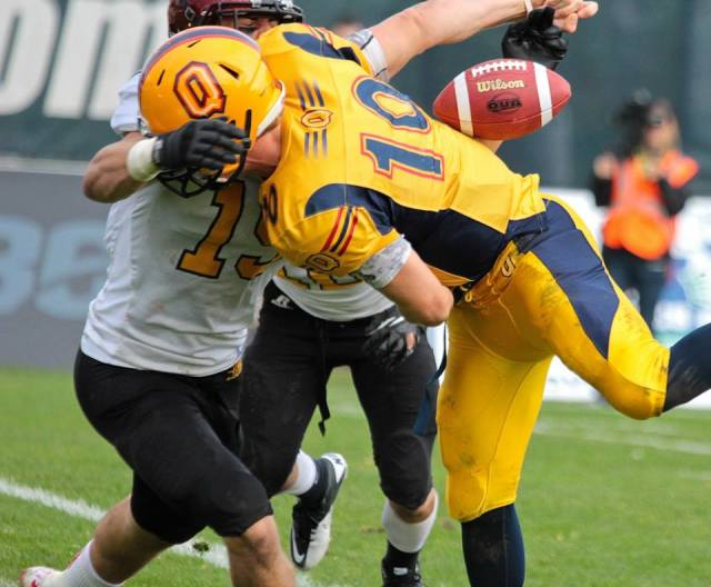 With Queen's on the Guelph 5-yd line and threatening to score LB Curtis Newton sacked the Billy McPhee and forced a fumble. The play resulted in a 12 yard loss for the Gaels. Photo: Lou Toppan