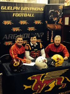 Arran MacRae signs his LOI today at Alumni Stadium photo: Cody MacRae