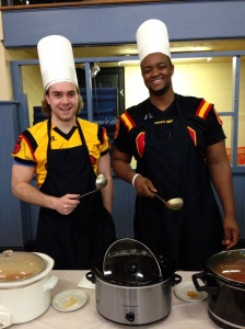 Rob Carnegie & Steve Mburanumwe serve soup