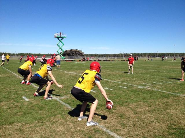Gryphon QBs work out under blue skies (l-r) Alec Reid, Mac Blewett #8 & Evan Murdza #5