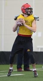 QB Mack Blewett practicing in Gryphon Fieldhouse