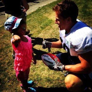 Argonaut & former Gryphon Jake Reinhart talking to a little fan on Argos Fan Appreciation Day in 2014