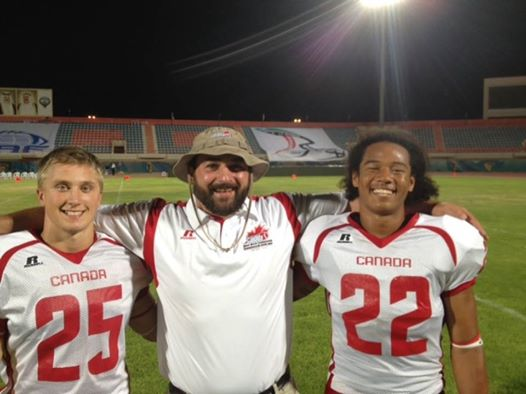 Team Canada LB Coach Kevin MacNeill with DBs Nick Parisotto (l) and Royce Metchie