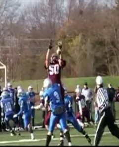 MacRae #50 leaps high to block a pass in 2011