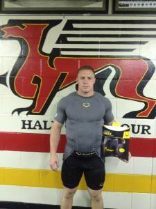Rob Farquharson models the new EvoSheild protective girdle that Gryphon football player was outfitted with.