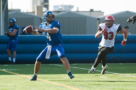 Freshman recruit Charlie Taggart getting after Carabins QB Gabriel Cousineau Photo: carabins.umontreal.ca