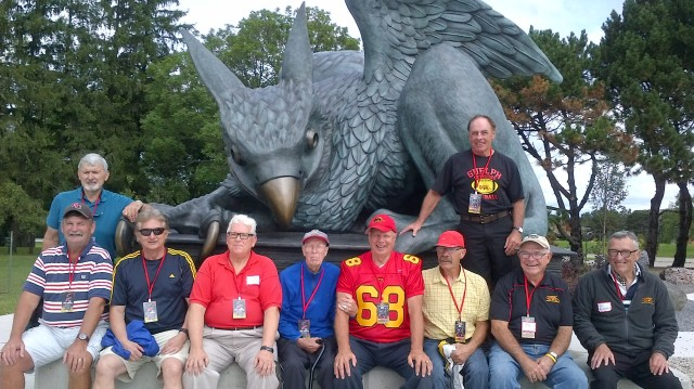 Members of the 1970 team pose at the Gryphon Statue prior to Saturday's game Seated (l-r) - Rob Cooke, Rodger Hunter, Don FitzGerald,  Bill Morrison Sr., Dr. Bill Morrison, Paul Zvonkin, Dr. Greg Topolie, Dr. Al Robinson. Standing - Gary Scapinello & Barry Pyear.