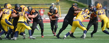 LG Andrew Pickett and LT Steve Mburanumwe open a hole for RB Brandon Gordon Photo: Rob Massey / Guelph Mercury