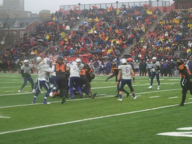 A wet but enthusiastic crowd enjoys 1ft half action. Photo: Doug Pflug