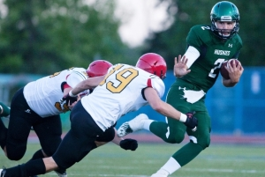 U of S Huskies' quarterback Drew Burko tries to evade Guelph Gryphon tacklers in Aug 2012 exhibition game Photo: Michelle Berg / Star-Phoenix