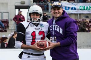 Daniel Ferraro receives commemorative ball at the Yates Cup from previous record-holder Lirim Hajharullahu.