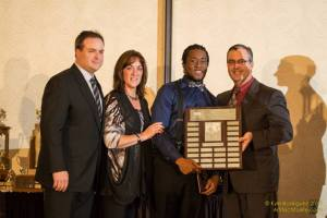 Tristan Douglin receives the Kohler Perserverence Award from Rick's brothers & sister