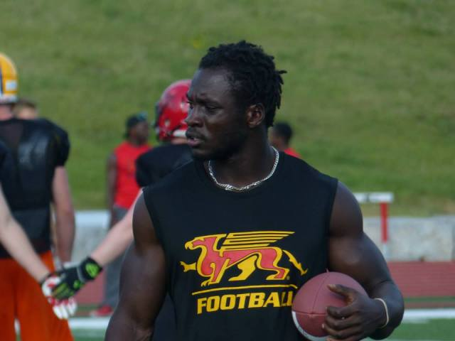 Running back Johnny Augustine