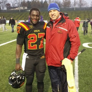 Johnny Augustine with mentor Doug Pflug,  a previous Gryphon tailback himself