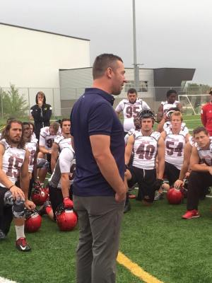 Kyle Walters addresses Gryphons at Univ of Manitoba practice fields in August