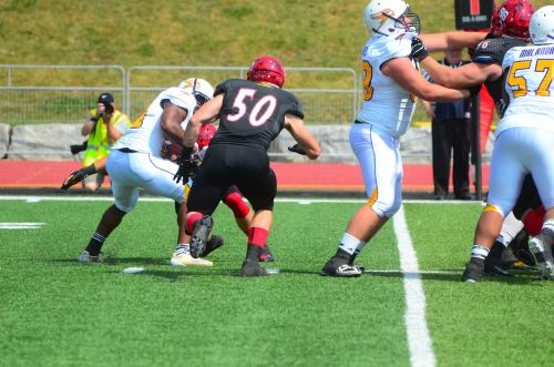 Gryphons wrap up WLU's Dillon Campbell for a loss Photo: Lou Toppan