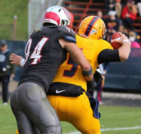 Blake McNeely sacks Queen's QB Photo: Lou Toppan