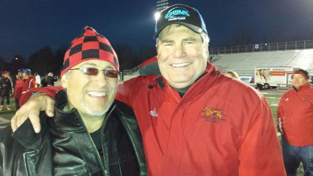 Friends of Gryphon Football President Randy Dimitroff and Coach Stu Lang pose for a picture in the midst of the post-game celebrations