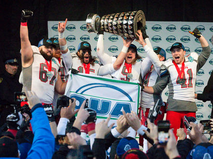 Guelph Gryphons football players Matthew Nesbitt, left, James Ingram, Curtis Newton, John Rush, James Roberts and Patrick McGrath hoist the OUA Yates Cup over their heads after winning the provincial championship football game by beating the Western Mustangs 23-17 at TD Stadium in London, Ont. on Saturday November 14, 2015. Craig Glover/The London Free Press/Postmedia Network