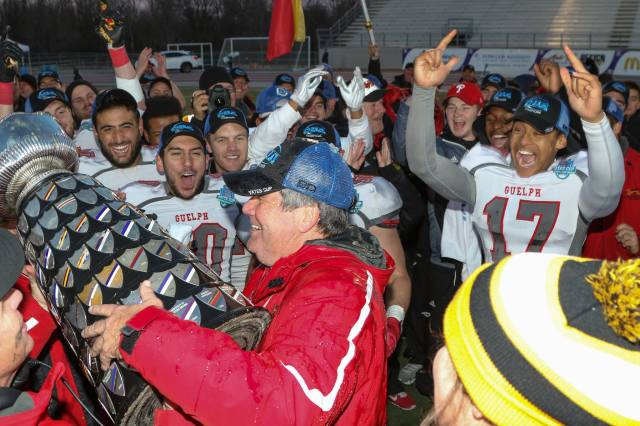 Coach Lang holds the Yates Cup Photo: Lou Toppan