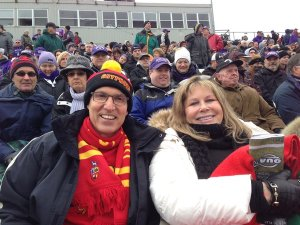 UofG President Franco Vaccarino and Kim Lang cheering on the Gryphons at the 108th Yates Cup
