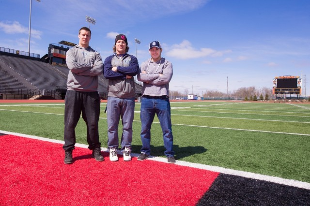 Three former Gryphons currently on the Argos roster (l-r) Cam Walker, Jake Reinhart &Dan MacDonald Photo: Gryphons.ca