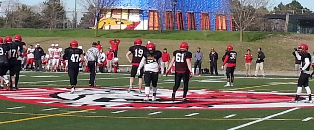 Gryphon defense in scrimmage at York with #19 Aidan England, #61 Riley Baines, #36 Akeem Knowles