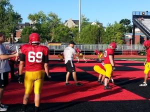 Asst coach Adam Bestard working with O-Line on Day5