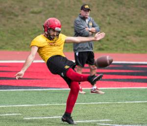 Gabriel Ferraro punting with Coach Gary Jeffries looking on Photo: Rob Massey